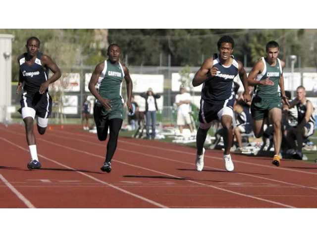 Sprinters compete in the 100 on Thursday. The Saugus boys varsity team defeated Canyon 77-59 at Canyon High.