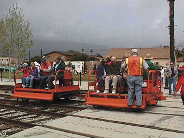 "Visitors enjoy riding on ""speeders"" at a previous Railfest."