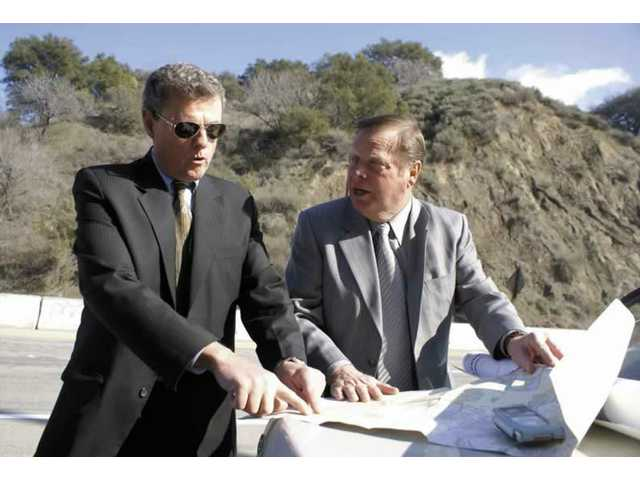 Santa Clarita Mayor Bob Kellar, right, and Paul D. Brotzman, director of Community Development for the city, study a map of Las Lomas in front of the property on The Old Road.