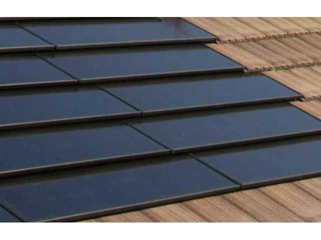 A close-up of one type of photovoltaic solar roof tiles made by SunTile, designed to integrate with existing roof tiles.
