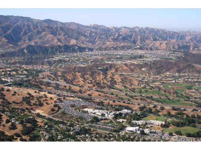 A view to the west over Santa Clarita Valley, with College of the Canyons' main campus in the foreground and unincorporated SCV communities including Stevenson Ranch in the distance.