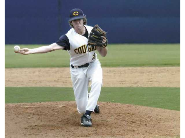 College of the Canyons pitcher Caleb Deville, a Valencia High School graduate, pitches the ball in a game against Glendale College. The Cougars beat Glendale 9-6