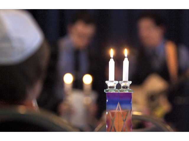 Members of Or Emet, a Jewish Congregation for Jewish Living observe the Passover holiday after lighting the candles during the second night of the Passover Seder.