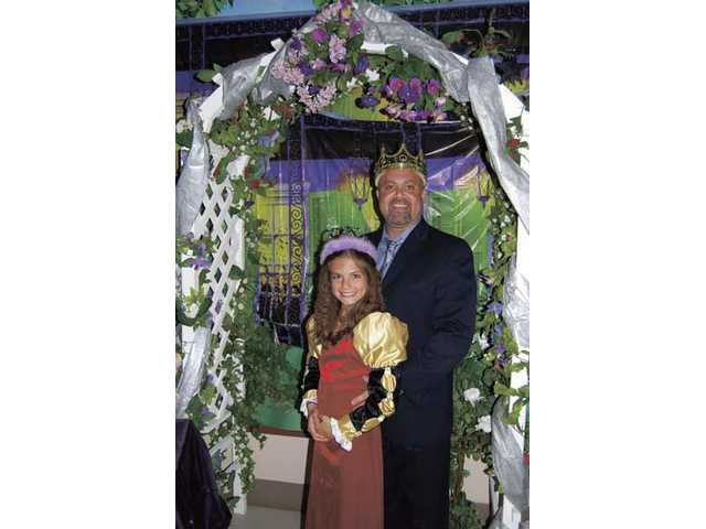 Madison McGivern and her father were crowned as winners of the Waltz Contest.