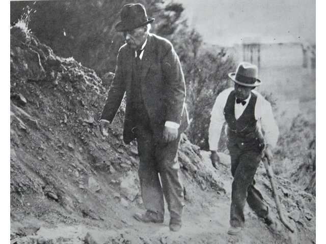William Mulholland, left, and H.A. Van Norman inspect the remains of the St. Francis Dam after its collapse.