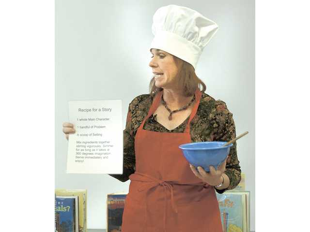 Mary Ann Fraser, author of children's books, wears her cooking clothes Friday as she describes the ingredients needed to make a storybook at Plum Canyon Elementary School.