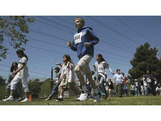 Rosedell Elementary students run laps to raise money for disaster supplies,  spring assemblies and field trips.