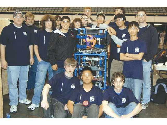 Robotics team members and mentors Front from left: Nathan Kish, Marcus Kwak, Brandon Bussjaeger.  Back from Left: Dennis Smalley, Rich Petras, Andy Bax, Garret Smalley, Ali El-Arabi, Tommy Peterson, Brandon Robbins, Richard Petras, Brian Lee, Patrick Allen, Anish Sawant, Choongil Lee, Gary Haggarty.