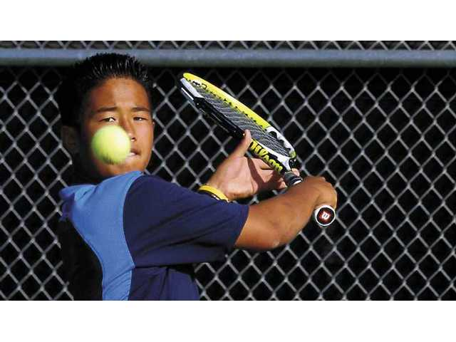 West Ranch boys tennis player Jaishen Wei hits the ball in his final set against Saugus High player Jordan Ta. West Ranch defeated Saugus 15-3.