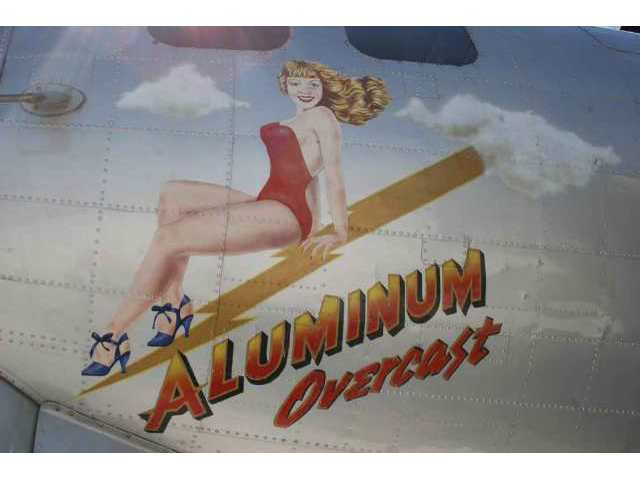 "The nose art on the ""Aluminum Overcast"" is pretty tame, according to Lt. Col. Robert H. Springer, B-17G pilot during World War II who watched the plane fly at Fox Airfield in Lancaster Monday. ""She's wearing clothes,"" he noted. ""Not all of them did."""