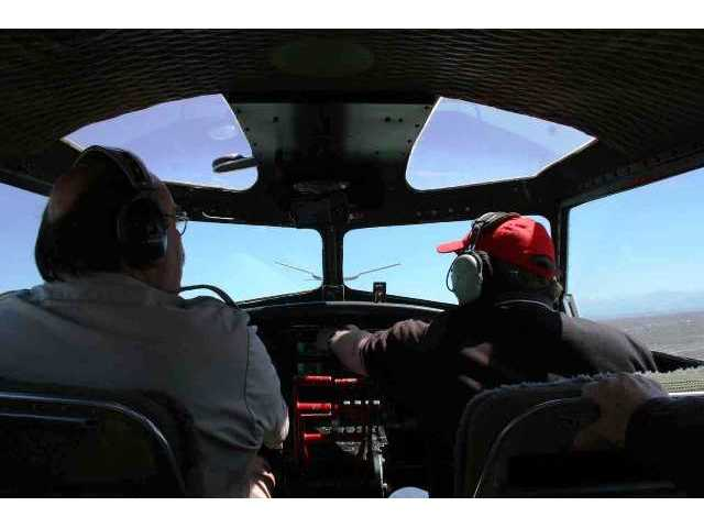 """Pilot George Daubner (left) is head of the EAA's """"Salute to Veterans"""" tour, and sometimes flies the B-17G as well. Copilot Sean Elliott is the EAA's head of flight operations and maintenance."""