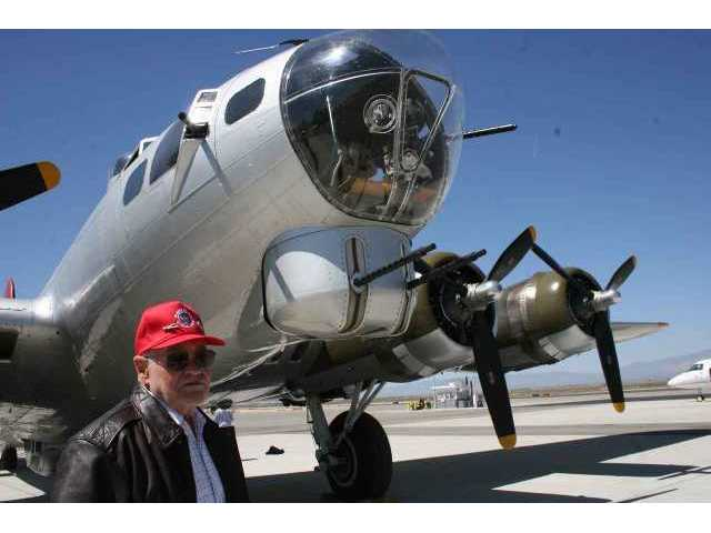 "Lt. Col. Robert H. Springer, USAF Ret., pilot of a B-17G on 35 combat missions over Europe during World War II, inspects ""Aluminum Overcast"" Monday at Fox Airfield in Lancaster."