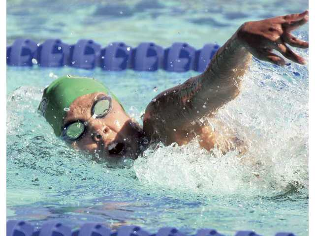 Canyon High's Kirsten Justice swims in the girls 200 IM at the Santa Clarita Aquatic Center Tuesday. The Canyon girls defeated Saugus on Tuesday.