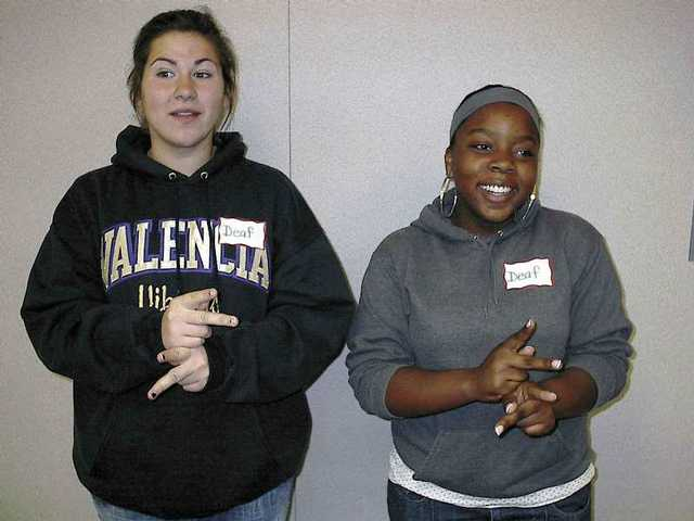 Valencia High School students in American Sign Language classes recently pretended to be deaf for a day and spoke only in sign language.