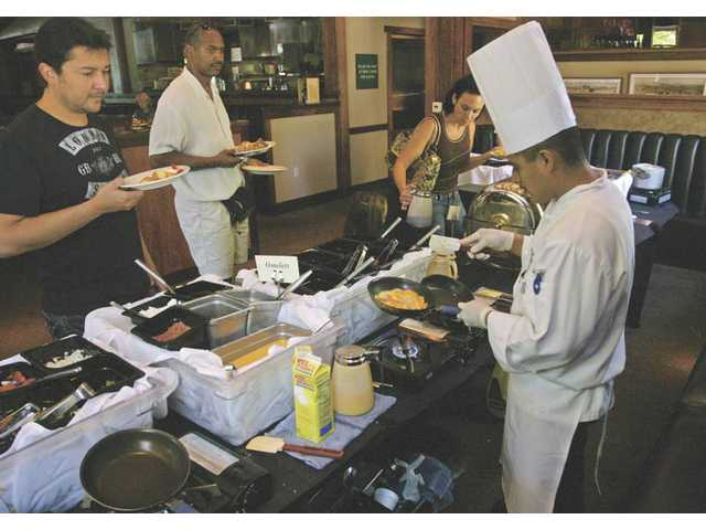 The omelet station at Salt Creek Grille. Salt Creek will also offer other tasty menu items this Sunday.