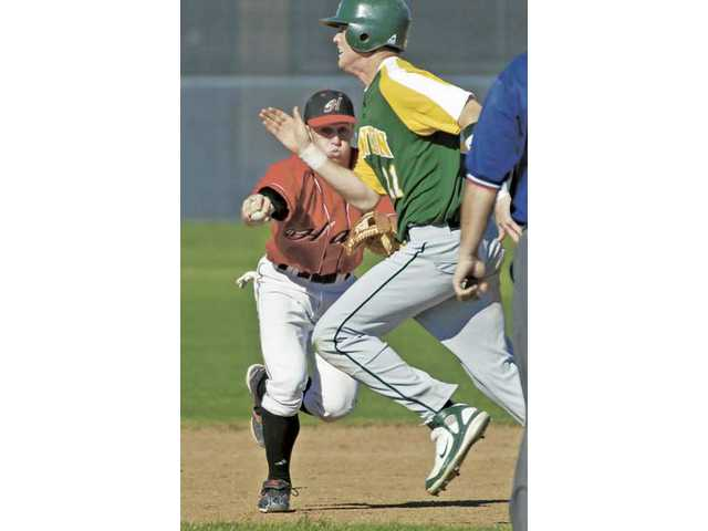 Hart's Spenser Souza, back, makes the tag on Canyon's Chili Viall, front, Wednesday at Hart.