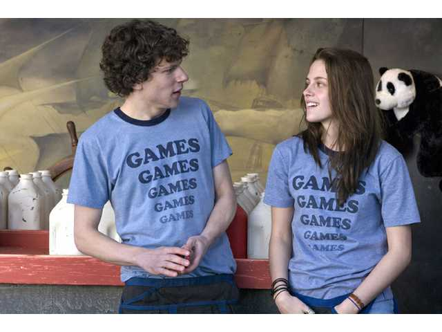 "Jesse Eisenberg, left, and Kristen Stewart are shown in a scene from, ""Adventureland."" The film is rated R for language, drug use and sexual references."