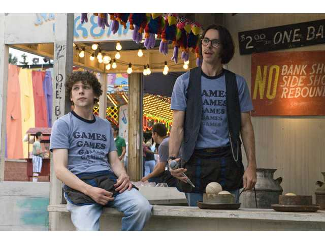 "Jesse Eisenberg, left, and Martin Starr are shown in a scene from the Miramax film ""Adventureland."""