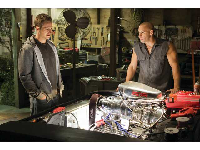 "Paul Walker, left, and Vin Diesel in ""Fast & Furious."""