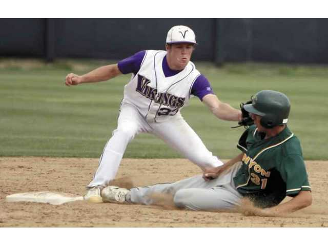 Valencia's Taylor Dingman (33) tags Canyon's Robert Wright as he slides into second base Wednesday. Wright was ruled safe on the play, but Canyon fell 5-2.