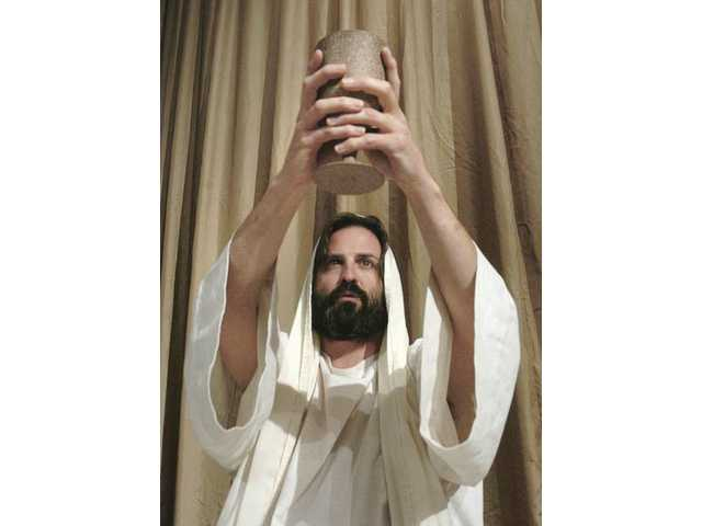 Phil Hyland, playing Jesus, rehearses a scene.