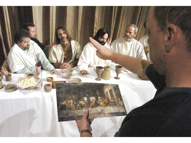 "Director of ""The Last Supper"" Guy Distad, right, arranges Phil Hyland, center, as Jesus and the disciples to match the famous Leonardo Da Vinci painting of ""The Last Supper"" as they rehearse an Easter performance at Chirst Lutheran Church on Tuesday."