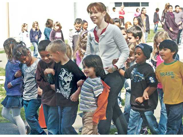 Emblem Elementary first-grade teacher Gretchin Pressman and her class join in a walk on Friday with more than 360 other students in grades kindergarten through sixth grade, which was an event organized to help those who suffer from cystic fibrosis. The event raised $4,297 to  help fight the disease.