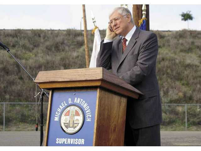 Supervisor Michael D. Antonovich prepares to speak during the inaugural presentation Wednesday of a public transit bus linking the SCV to the LA/Palmdale airport.