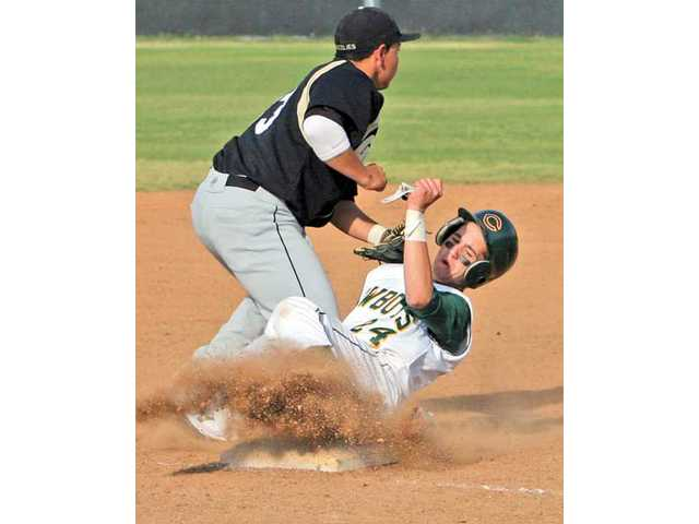 Canyon's Jacob Kelsey, right, slides into third base as Golden Valley's Jon Granado waits for the throw Friday at Canyon.