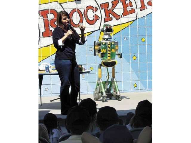 SCV Waste Management's Sandra Pursley and her friend Cycler talk to Rio Vista Elementary classes at Thursday's Environmental Awareness and Career Day.
