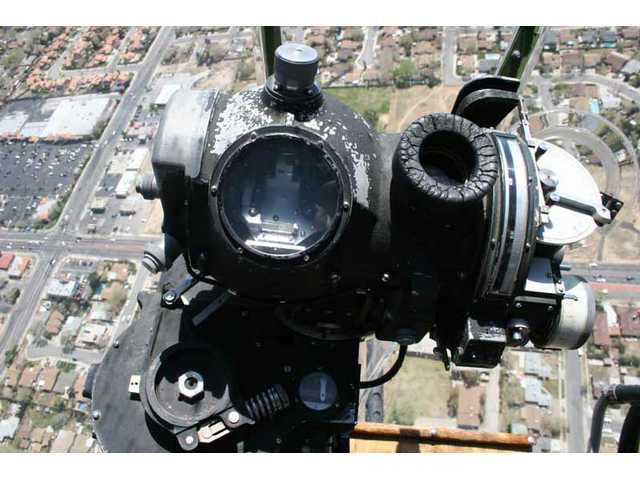 """...Cause I've got you in the sight of my...."": a closeup of the B-17 ""Aluminum Overcast"" bombsight on a flight over Lancaster Monday."