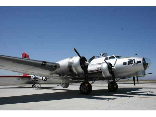 """Aluminum Overcast"" sits on the tarmac at Fox Airfield in Lancaster before taking reporters on a flight Monday."