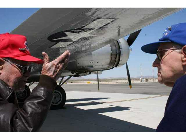 "Lt. Col. Robert H. Springer and Staff Sgt. Adolph (""Adie"") M. Fix, both veterans of combat missions in B-17s over Europe during World War II, share a few memories after they watched ""Aluminum Overcast"" take off and land at Fox Airfield in Lancaster."