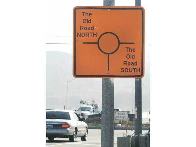 A sign posted on Hasley Canyon Road looking east displays the image of the roundabout intersection at Hasley Canyon Road and The Old Road in Castaic on Thursday. Officials hope to improve traffic flow when the $41 million project is completed later this year.
