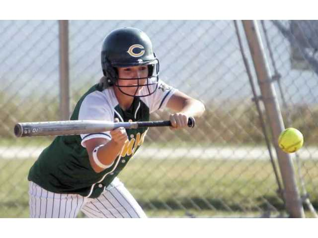 Canyon High's Amanda Hermann attempts a bunt during her squad's14-1 victory over the Golden Valley Grizzlies on Thursday afternoon.