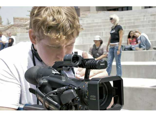 Spencer Hammerstad, a senior at Golden Valley High School, was among the video crew catching the action at last May's Summer Meltdown Autism Awareness and Social Inclusion Concert, staged by the Hart district's Yes I Can students at the GV outdoor amphitheater.