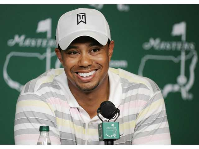 Tiger Woods speaks during his press conference at the Masters golf tournament in Augusta, Ga., Monday, April 5, 2010. The tournament begins Thursday, April, 8.