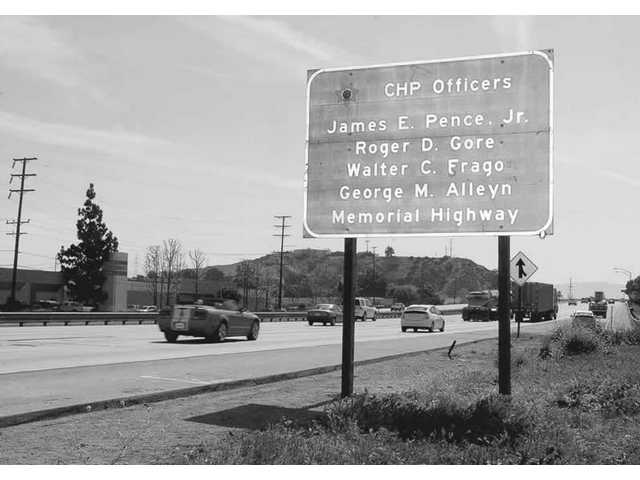 Signs mark a section of Interstate 5 that is now named after four California Highway Patrol officers who were killed in the Santa Clarita Valley on April 6, 1970. The dedication ceremony was held on Friday.