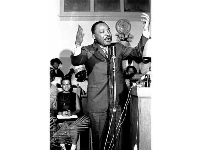 "Civil rights leader the Rev. Dr. Martin Luther King Jr. gestures during a speech at a political rally in Montgomery, Ala., in this April 29, 1966 file photo. Now, four decades after his assassination, the anniversary of his death is marked by a documentary that explores his life and legacy. ""King"" airs Sunday at 8 p.m. on the History Channel."