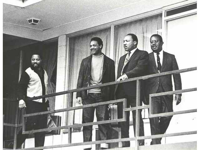 "The Rev. Dr. Martin Luther King, second right, and Southern Christian Leadership Conference aides Hosea Williams, Jesse Jackson Jr., from left, and Ralph Abernathy return to the Lorraine Motel in Memphis to strategize for the second sanitation workers' march in this April 3, 1968 file photo. King was shot dead on the balcony at 6:01 the next evening. The photo is part of the exhibition ""From Memphis to Atlanta: The Drum Major Returns Home"" at Atlanta's Martin Luther King Jr. National Historic Site April 4-Aug. 31, 2008."