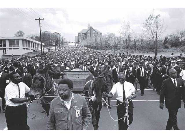 "This April 9, 1968 photo released by the MLK Jr. National Historic Site shows the Rev. Dr. Martin Luther King's body en route to Morehouse College in Atlanta, on a mule-drawn wagon accompanied by his aides dressed in denim attire. The wagon, mules and clothes symbolized the Poor People's Campaign. This photo is part of the exhibition ""From Memphis to Atlanta: The Drum Major Returns Home"" at Atlanta's Martin Luther King Jr. Historical Site April 4-Aug. 31, 2008."