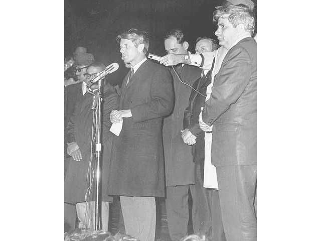 Robert F. Kennedy, shown in this April 4, 1968 file photo, speaks to an Indianapolis, Ind., crowd telling them of the assassination of the Rev. Dr. Martin Luther King Jr. earlier that evening. As riots erupted in dozens of cities, Kennedy's speech that night is credited for helping keep Indianapolis calm.