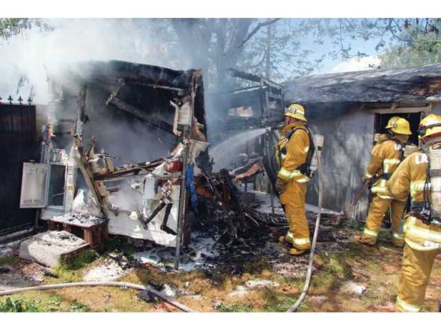 A fire destroyed a travel trailer and damaged the roof of another building at 23951 Race Street in Newhall on Monday.  Los Angeles County Firefighters from stations 73 and 126 quickly knocked down the blaze.  No injuries were reported, and the reported cause of the fire was transients living on the abandoned property.