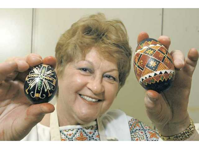 Olga Kaczmar displays two of her finished Russian pysanky eggs at an egg decorating class she taught at the Senior Center on Thursday.