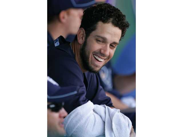 Tampa Bay Rays pitcher James Shields smiles while sitting in the dugout during the third inning against the Red Sox in Fort Myers, Fla. on March 22. The Rays defeated the Red Sox 11-9.