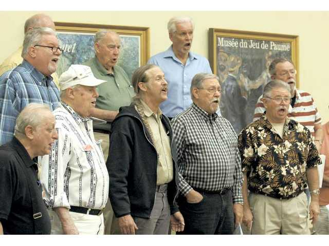 "SCV Men of Harmony, a local barbershop quartet, practice the song ""Under the Boardwalk"" at the Valley Oaks Apartment Clubhouse on Tuesday."