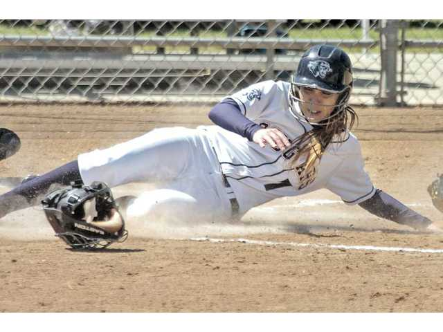 College of the Canyons' Beth Ranken slides into home safely at COC on Tuesday.