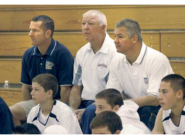 (From left to right) Dave, Bill and Deron White watch a youth basketball game in Castaic on Saturday.
