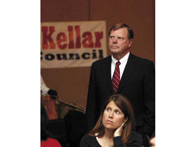Mayor Bob Kellar, who voters re-elected to the council, listens to candidate Bob Spierer's concession speech at the Hyatt Valencia.