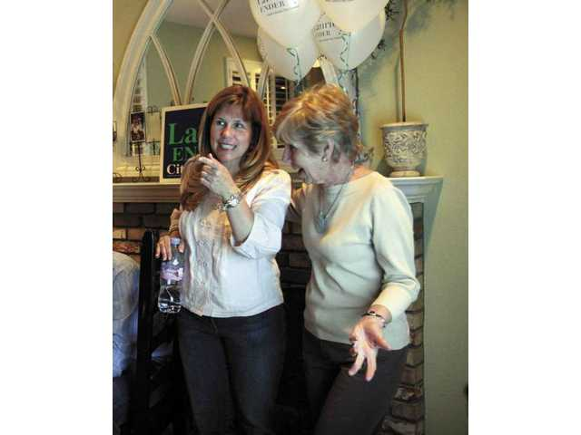 Laurie Ender celebrates her City Council election victory with her mother Sue Holt on Tuesday night at Ender's home.